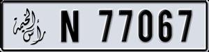 77067